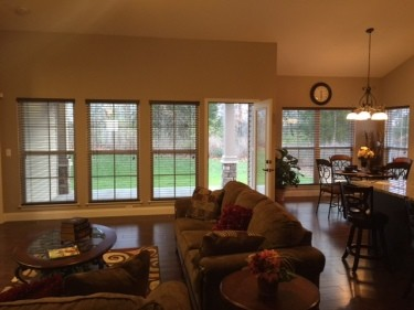 Great room 3 windows and covered patio view.JPG