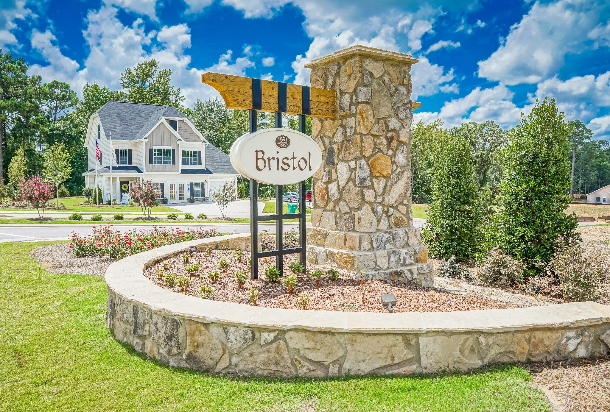 Bristol community entrance sign and model home in