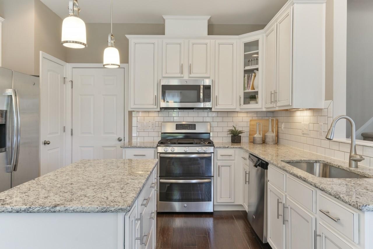 The Wilmington, model home, Clayton NC, Kitchen, White Kitchen, Granite Countertops, New Homes in...