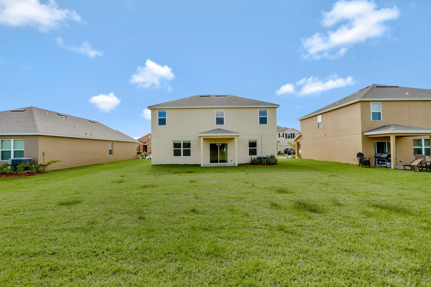 3390 Rockport St SW Vero Beach-large-020-19-Rear Exterior-1500x1000-72dpi.jpeg